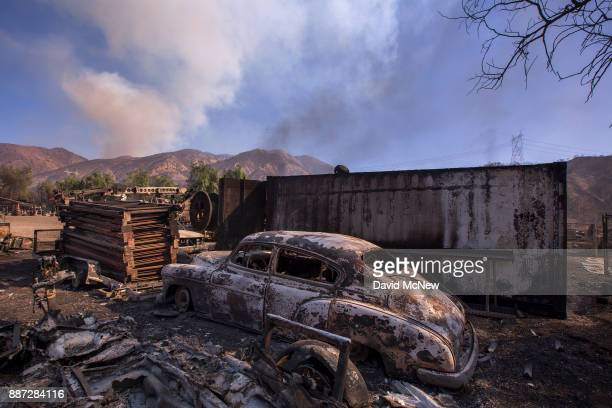 A burned classic car is seen in Little Tujunga Canyon during the Creek Fire on December 6 2017 near Sylmar California Strong Santa Ana winds are...