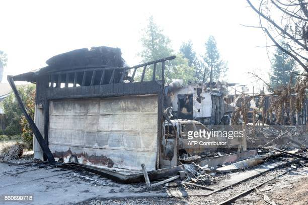 A burned house is seen in Santa Rosa California on October 12 2017 Hundreds of people are still missing in massive wildfires which have swept through...