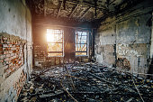 Burned interiors of industrial hall after fire in the factory.
