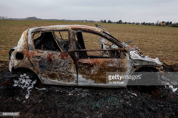 Burned out Car in field