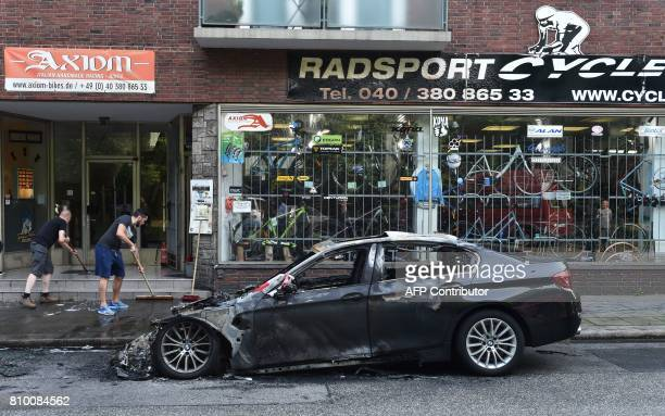A burned out car is seen on July 7 2017 in Hamburg northern Germany where leaders of the world's top economies gather for a G20 summit Protesters...