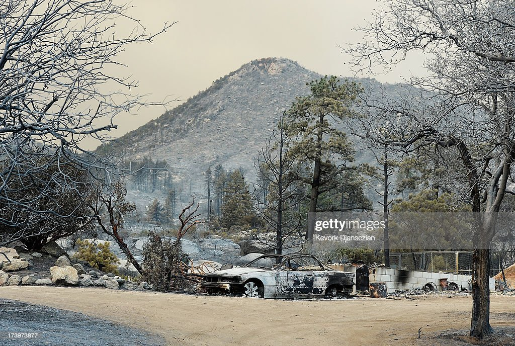 Burned out cars are shown in the wake of the Mountian Fire after it scorched the area on July 18, 2013 near Idyllwild, California. The massive wildfire in Riverside county has grown to 23,000 acres and is advancing toward the mountain town of Idyllwild on one front and city of Palm Springs on the other front destroying several homs and forcing the evacuation of 6,000 people.