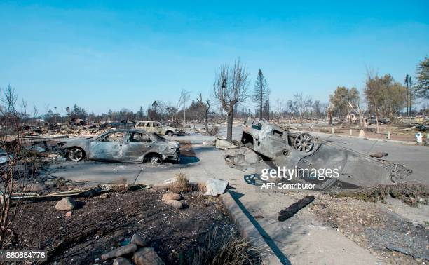 Burned out remains are seen in Santa Rosa California on October 12 2017 Hundreds of people are still missing in massive wildfires which have swept...