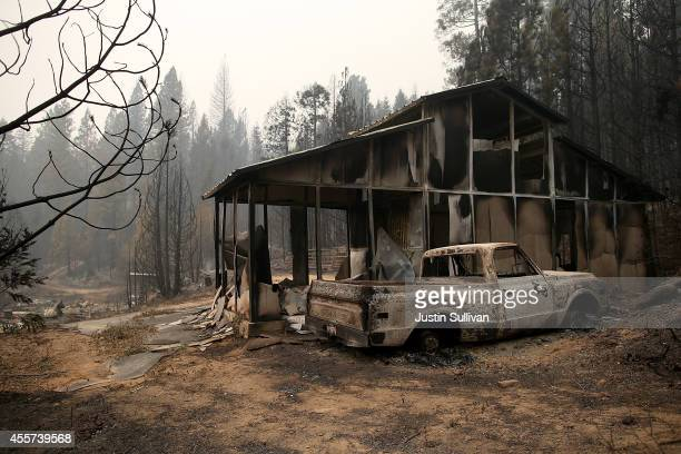 A burned out truck sits in front of a structure that was destroyed by the King fire on September 19 2014 near Pollock Pines California The King fire...