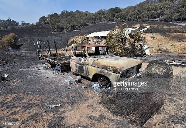 A burned out truck sits on an evacuated property as fire personnel battle the Rocky fire near Clear Lake California on August 1 2015 Thousands of...