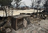 A burned out washer and dryer are seen amidst the rubble of a burned home during the Valley fire in Middletown California on September 13 2015 The...