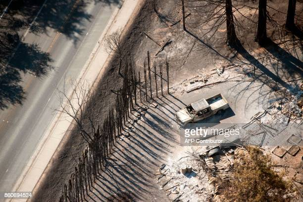 A burned property is seen from above in Santa Rosa California on October 12 2017 Hundreds of people are still missing in massive wildfires which have...