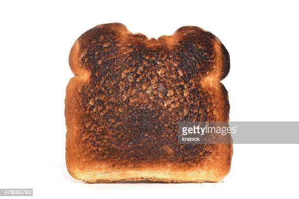 slice of burnt toast white background