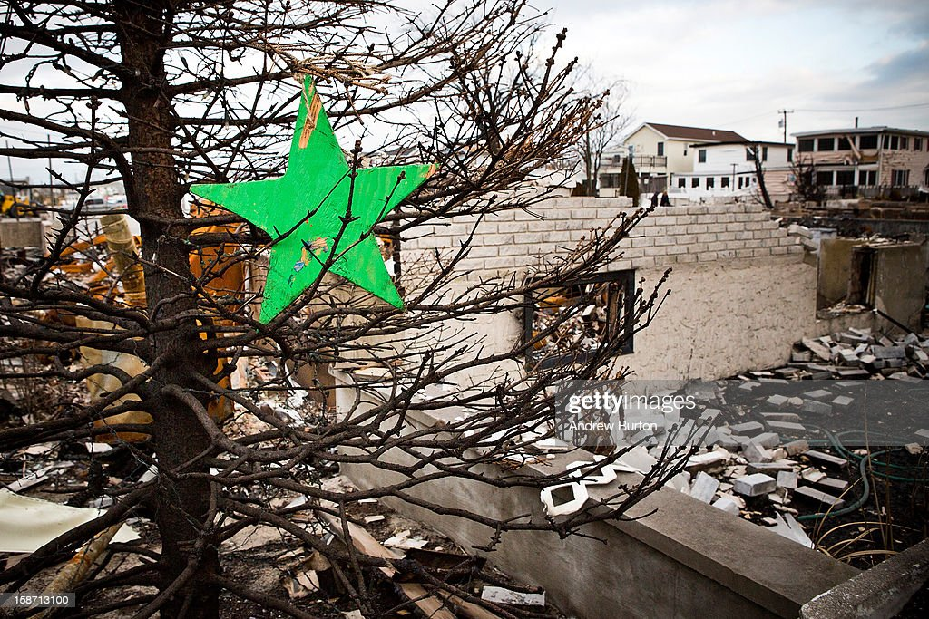 A burned tree is adorned with ornaments in the Breezy Point neighborhood of the Borough of Queens on December 25, 2012 in New York City.