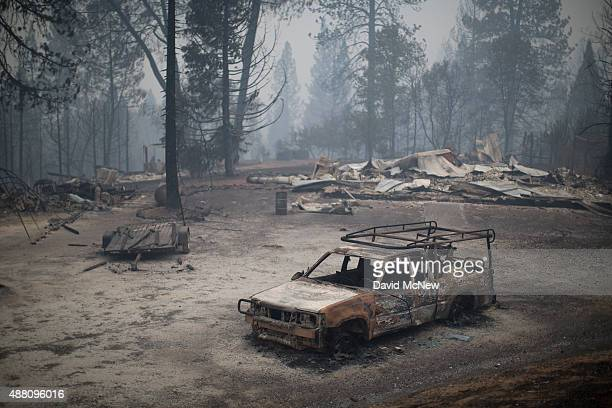 A burned truck and structures are seen at the Butte Fire on September 13 2015 near San Andreas California California governor Jerry Brown has...