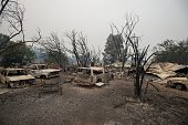 Burned vehicles sit at a property charred by the Valley fire in Middletown California on September 13 2015 The governor of California declared a...