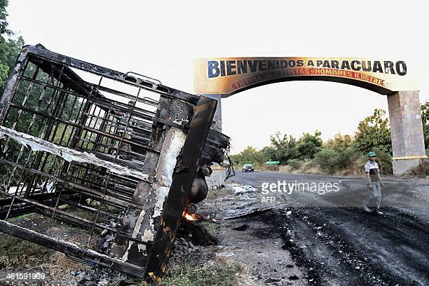 A burnedout bus outside the entrance of Paracuaro community is seem on the ApatzinganCuatro Caminos Road in Michoacan State Mexico on January 9 2014...