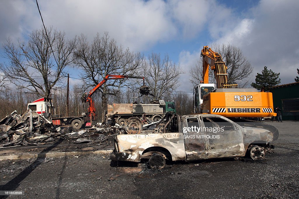 A burned-out truck is seen on the Hellenic Gold site in the forest of Skouries, some 620kms north of Athens, on February 17, 2013. Dozens of hooded men firebombed the premises of a Greek subsidiary of a Canadian gold mining company today, injuring a guard and damaging containers, cars and trucks. The site has faced opposition from citizens' groups who fear the project will cause irreversible harm to the local environment. They have been trying to halt the project since 2011, when the Greek government allowed Hellenic Gold, a subsidiary of Canadian company Eldorado Gold, to dig in the region. AFP PHOTO /Sakis Mitrolidis