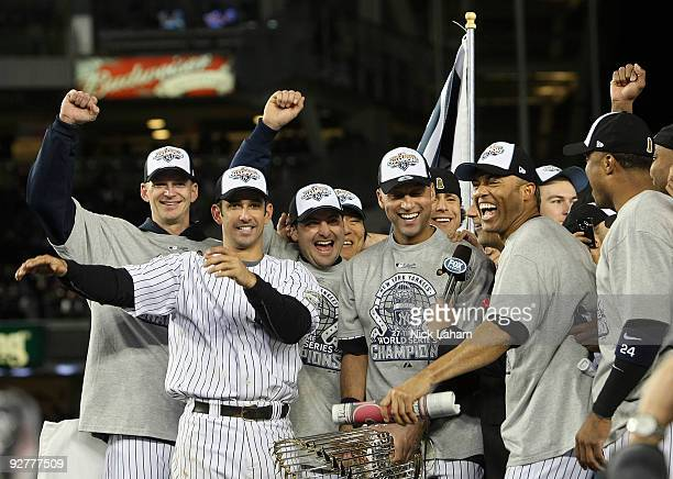 J Burnett Jorge Posada Derek Jeter and Mariano Rivera of the New York Yankees celebrate with their teammates after their 73 win against the...