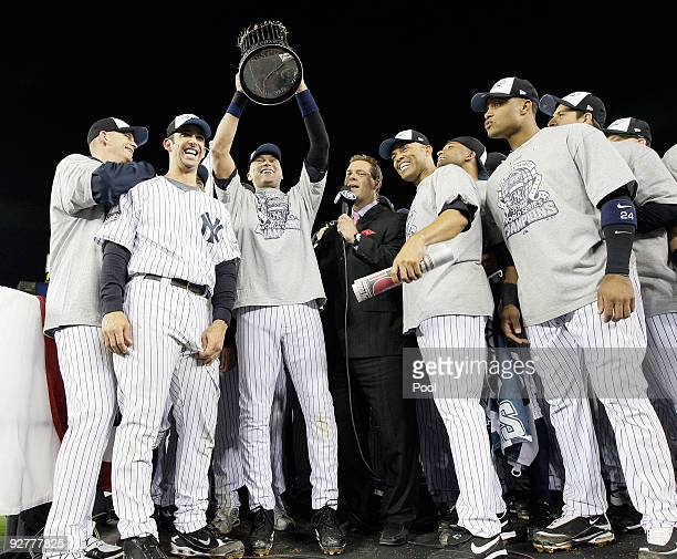 AJ Burnett Jorge Posada Derek Jeter Mariano Rivera and Robinson Cano of the New York Yankees celebrate with the trophy after their 73 win against the...