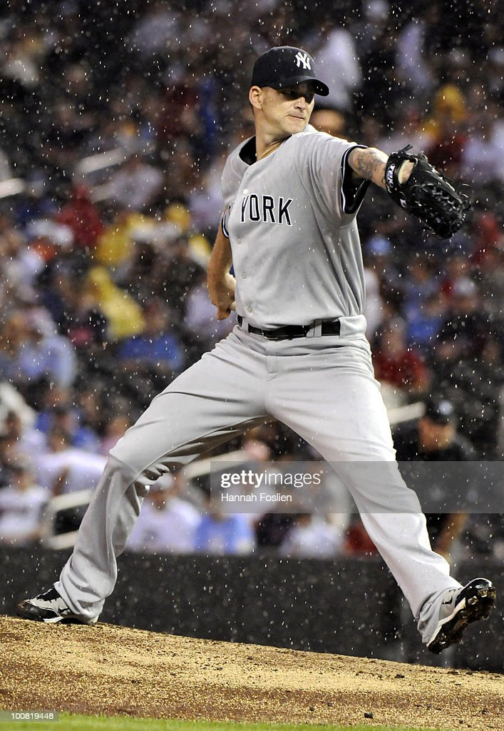 A.J. Burnett #34 of the New York Yankees pitches in the rain in the fifth inning against the Minnesota Twins during their game on May 25, 2010 at Target Field in Minneapolis, Minnesota.
