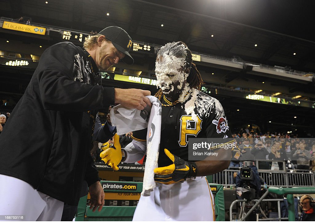 A.J. Burnett #34 of the Pittsburgh Pirates hits Andrew McCutchen #22 of the Pittsburgh Pirates with shaving cream after McCutchen hit a walk-off home run in the 12th inning to defeat the Milwaukee Brewers 4-3 at PNC Park on May 14, 2013 in Pittsburgh, Pennsylvania.