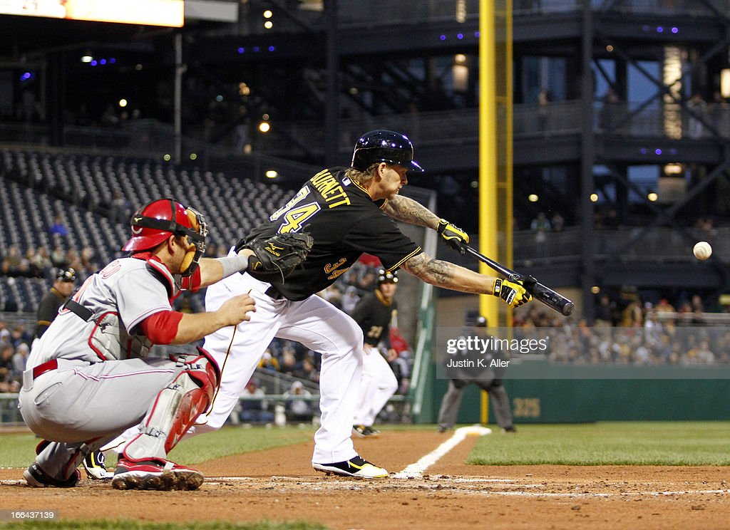 A.J. Burnett #34 of the Pittsburgh Pirates lays down a sacrifice bunt in the second inning against the Cincinnati Reds during the game on April 12, 2013 at PNC Park in Pittsburgh, Pennsylvania.