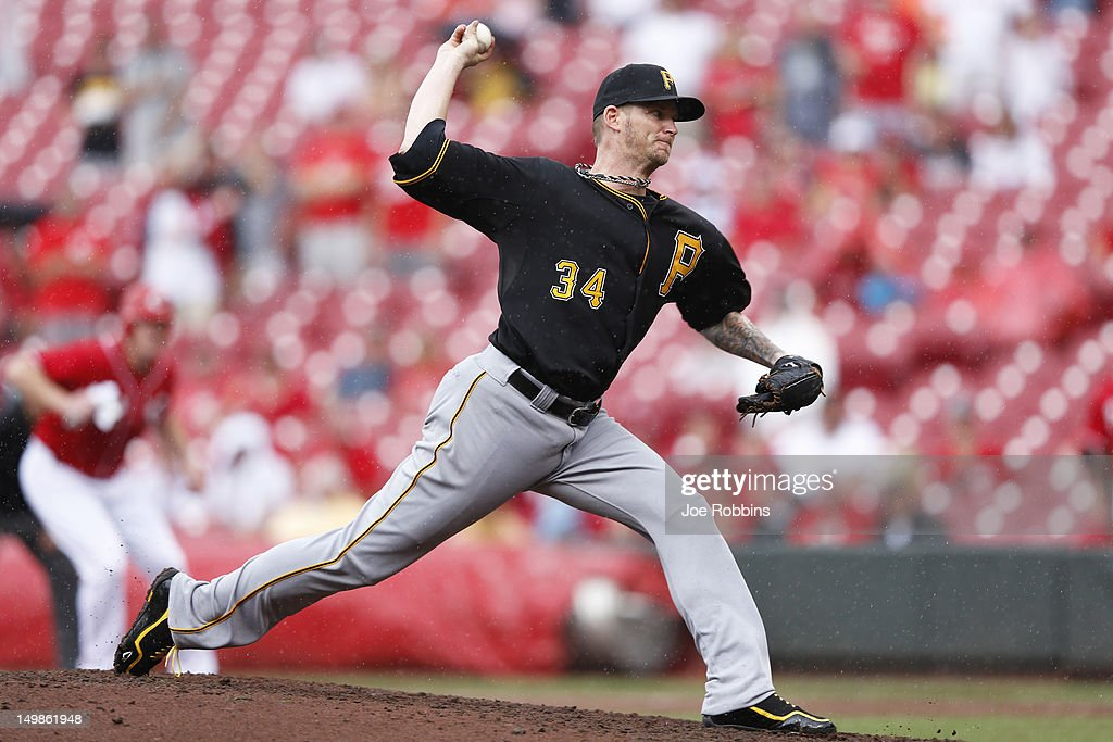 <a gi-track='captionPersonalityLinkClicked' href=/galleries/search?phrase=A.J.+Burnett&family=editorial&specificpeople=213103 ng-click='$event.stopPropagation()'>A.J. Burnett</a> #34 of the Pittsburgh Pirates pitches during the game against the Cincinnati Reds at Great American Ball Park on August 5, 2012 in Cincinnati, Ohio. The Pirates won 6-2.