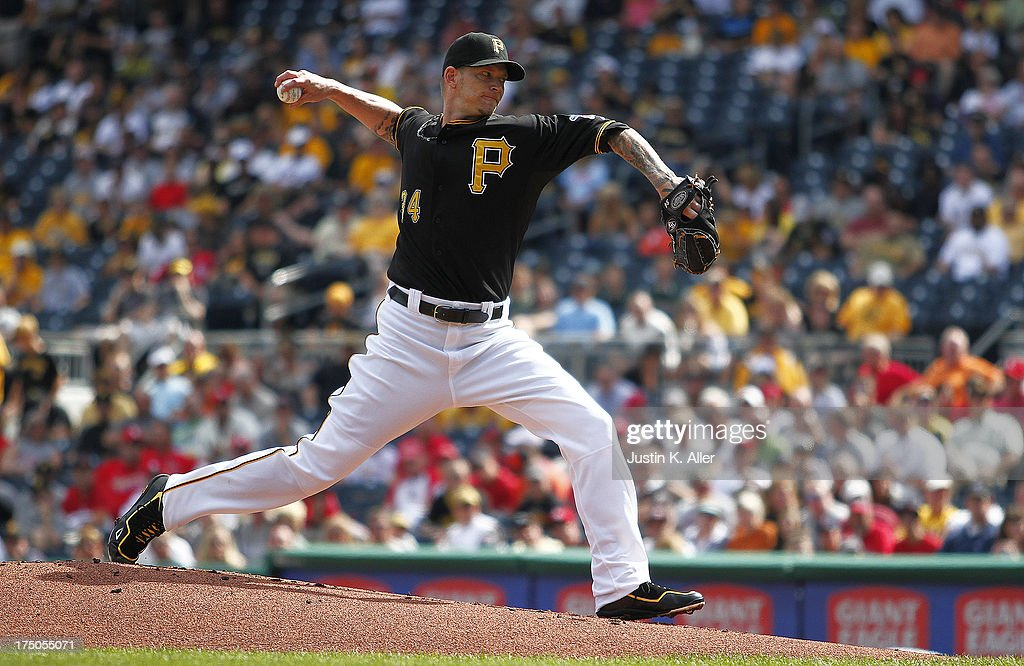 <a gi-track='captionPersonalityLinkClicked' href=/galleries/search?phrase=A.J.+Burnett&family=editorial&specificpeople=213103 ng-click='$event.stopPropagation()'>A.J. Burnett</a> #34 of the Pittsburgh Pirates pitches in the first inning against the St. Louis Cardinals during the game on July 30, 2013 at PNC Park in Pittsburgh, Pennsylvania.