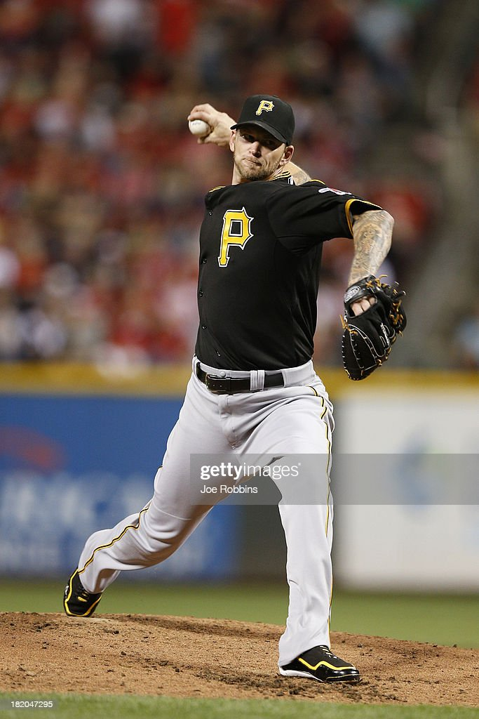 <a gi-track='captionPersonalityLinkClicked' href=/galleries/search?phrase=A.J.+Burnett&family=editorial&specificpeople=213103 ng-click='$event.stopPropagation()'>A.J. Burnett</a> #34 of the Pittsburgh Pirates pitches in the second inning against the Cincinnati Reds during the game at Great American Ball Park on September 27, 2013 in Cincinnati, Ohio.