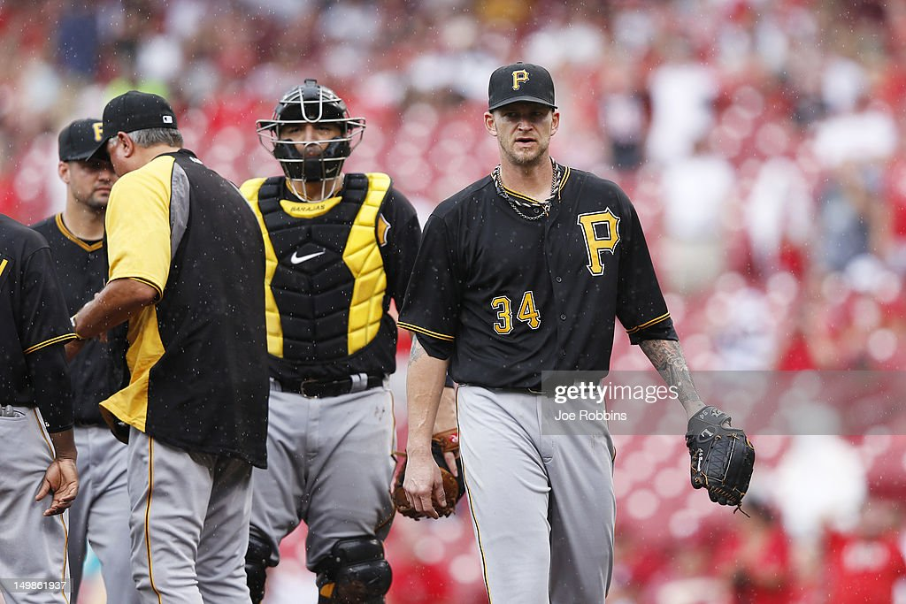 <a gi-track='captionPersonalityLinkClicked' href=/galleries/search?phrase=A.J.+Burnett&family=editorial&specificpeople=213103 ng-click='$event.stopPropagation()'>A.J. Burnett</a> #34 of the Pittsburgh Pirates reacts after being taken out in the ninth inning of the game against the Cincinnati Reds at Great American Ball Park on August 5, 2012 in Cincinnati, Ohio. The Pirates won 6-2.