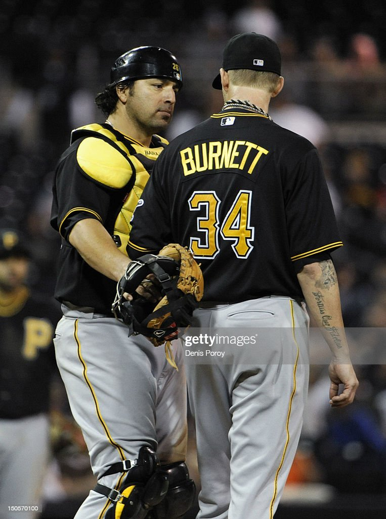 <a gi-track='captionPersonalityLinkClicked' href=/galleries/search?phrase=A.J.+Burnett&family=editorial&specificpeople=213103 ng-click='$event.stopPropagation()'>A.J. Burnett</a> #34 of the Pittsburgh Pirates, right, talks with <a gi-track='captionPersonalityLinkClicked' href=/galleries/search?phrase=Rod+Barajas&family=editorial&specificpeople=211198 ng-click='$event.stopPropagation()'>Rod Barajas</a> #26 after a run scored during the sixth inning of a baseball game against the San Diego Padres at Petco Park on August 21, 2012 in San Diego, California.