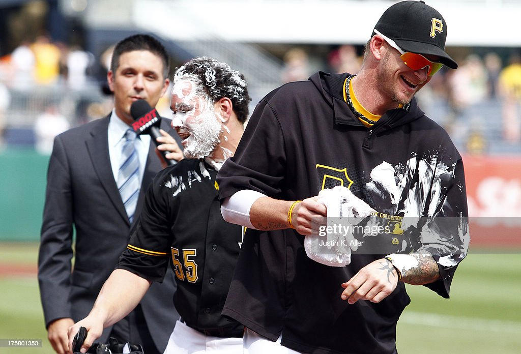 A.J. Burnett #34 of the Pittsburgh Pirates smashes a pie in the face of teammate Russell Martin #55 after hitting the game-winning RBI in the tenth inning against the Miami Marlins during the game on August 8, 2013 at PNC Park in Pittsburgh, Pennsylvania.