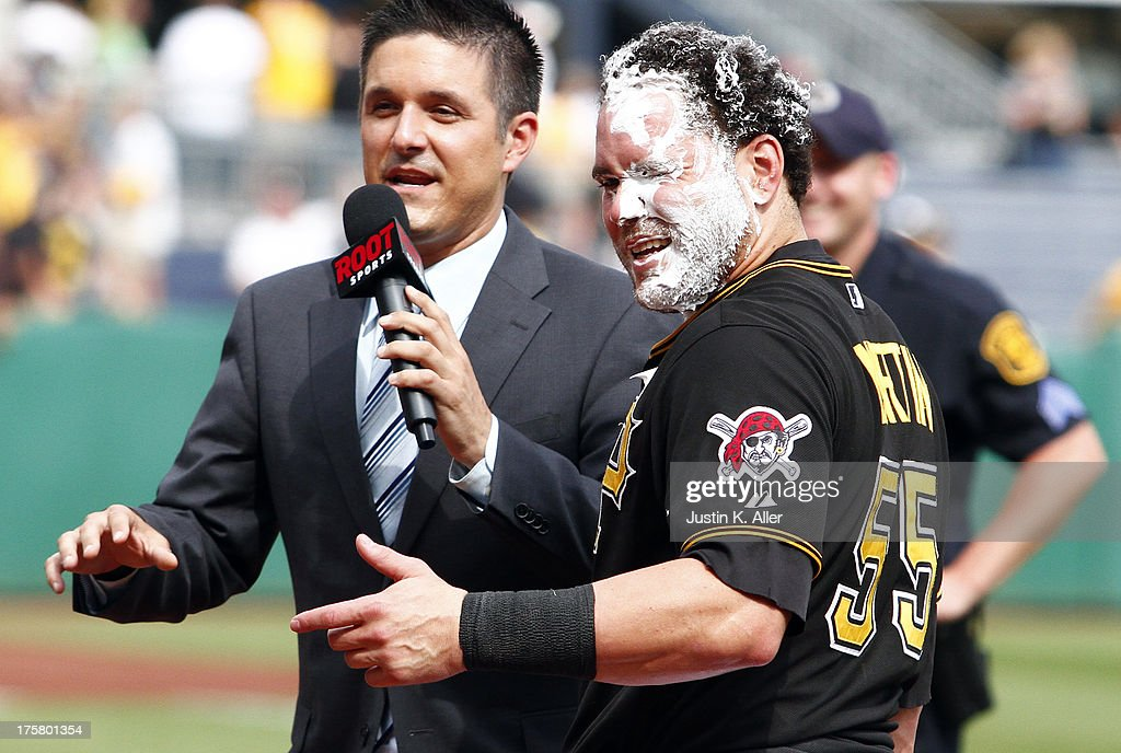 A.J. Burnett #34 of the Pittsburgh Pirates smashes a pie in the face of teammate <a gi-track='captionPersonalityLinkClicked' href=/galleries/search?phrase=Russell+Martin+-+Baseball+Player&family=editorial&specificpeople=13764024 ng-click='$event.stopPropagation()'>Russell Martin</a> #55 after hitting the game-winning RBI in the tenth inning against the Miami Marlins during the game on August 8, 2013 at PNC Park in Pittsburgh, Pennsylvania.