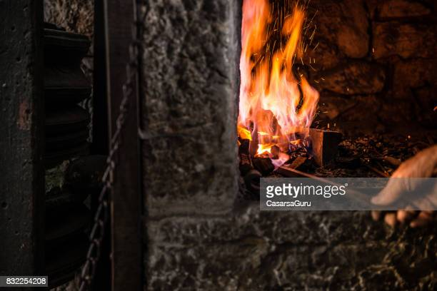Burning a Fire on Furnace in Blacksmith Shop