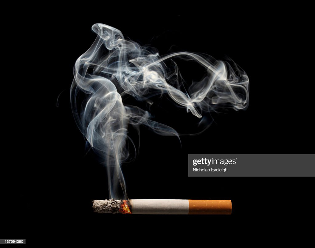 A burning and smoking cigarette