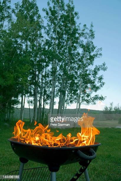 Burning BBQ at a camp ground at dusk