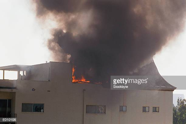 Burning building with smoke billowing out