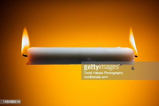 Burning candle at both ends : Stock Photo