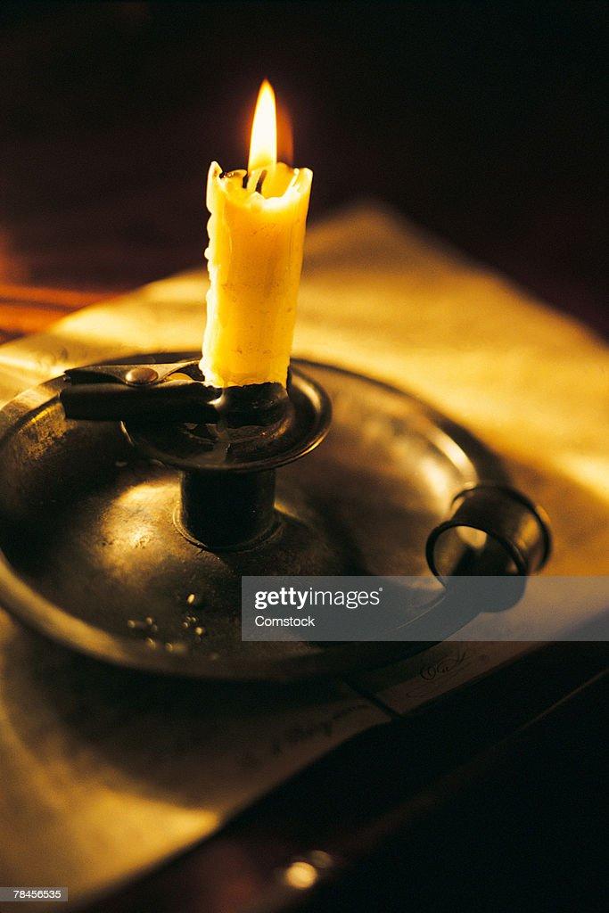 Burning candle in candleholder : Stock Photo
