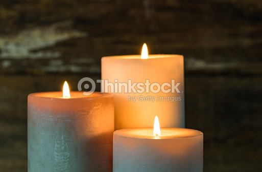 Burning candles in the dark. : Stock Photo
