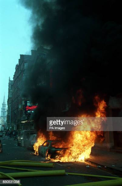 A burning car in St Martin's Lane central London in the wake of violence which erupted after a protest in Trafalgar Square against the socalled Poll...