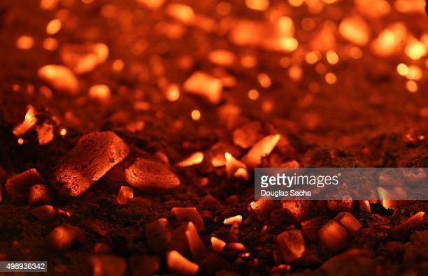 Burning embers from a fire pit