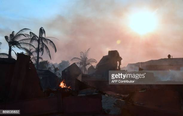 TOPSHOT Burning embers remain from a demolished home in the Anaheim Hills neighborhood in Anaheim California on October 9 after a fire spread quickly...