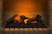 burning firewood in brick fireplace closeup