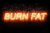 burning font burn fat fire word text with flame and smoke on black background, concept of medical diet nutrition healthy life style