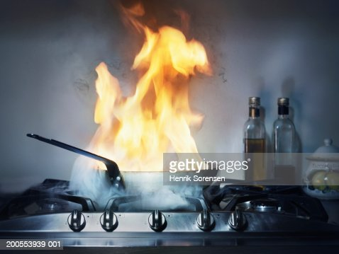 Burning Frying Pan In Kitchen Stock Photo Getty Images