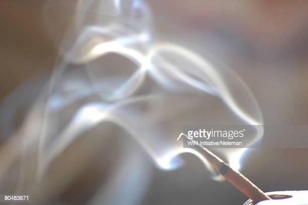 Burning incense stick, close-up, India