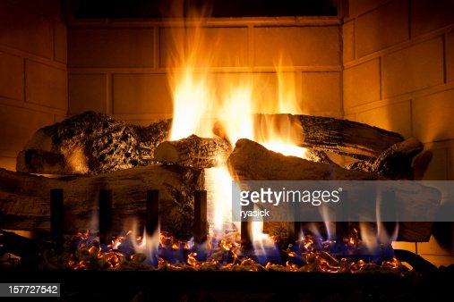 Burning Logs and Glowing Embers In Gas Fireplace