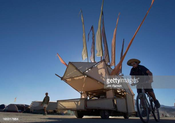 Burning Man art vehicle drives on the playa About 35000 are expected to camp out on the desert for the weeklong party and arts festival which ends...