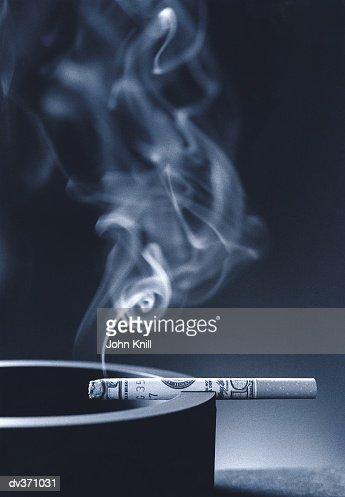 Burning money : Stock Photo