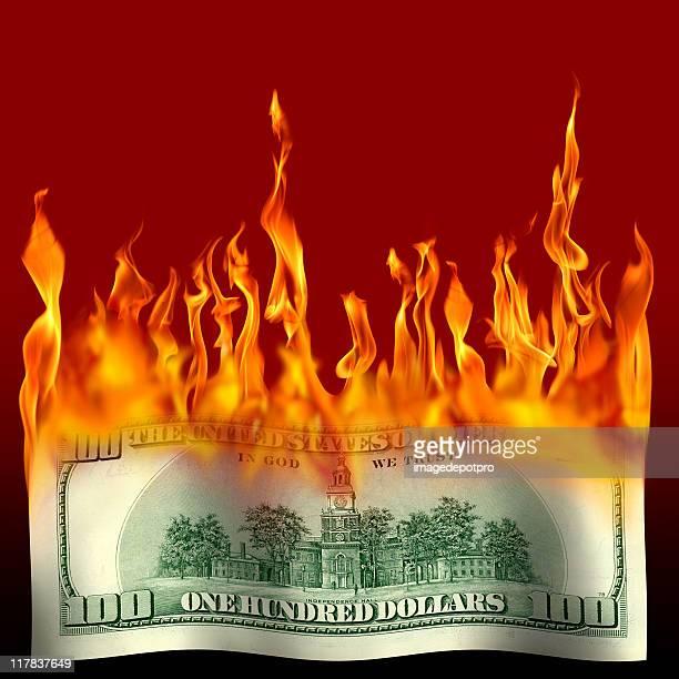 burning one hundred dollar bill