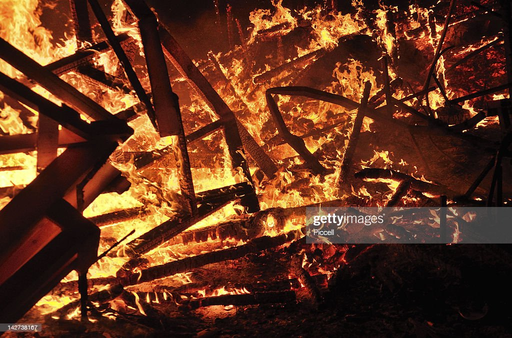 Burning remains of Falla street art in Valencia : Stock Photo