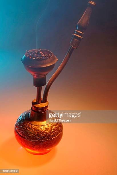 Burning smoking tobacco on a bong hookah