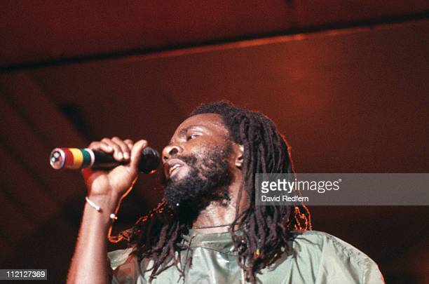 Burning Spear Jamaican roots reggae singer and musician singing into a microphone during a live concert performance circa 1983